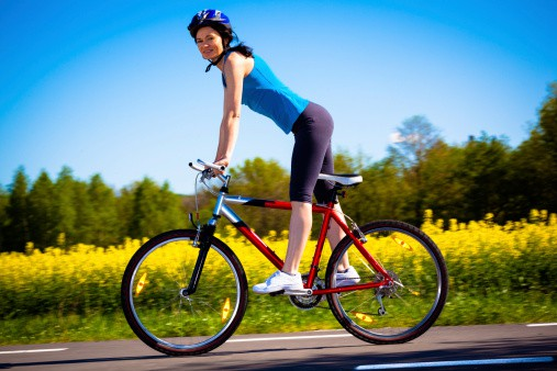 woman-happily-cycling-with-safety-helmet